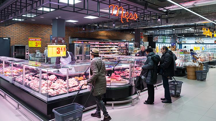Carrefour placerar kassan i matbutikens mitt